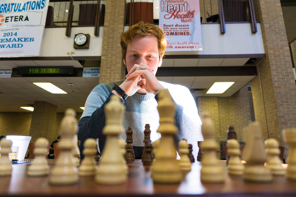 Zachary Starnes competes during the chess tournament in the pit on Feb. 21. Photo by Andrew Gonzales/The Et Cetera