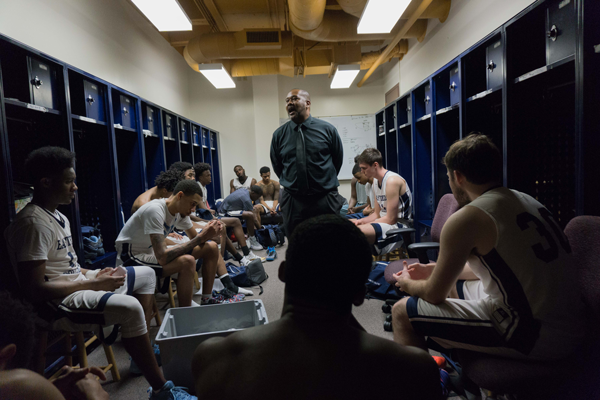 Coach Fletcher, center, gives his post-game delivery in the locker room following the Harvesters loss to Brookhaven. Photo by Andrew Gonzlaes/The Et Cetera.