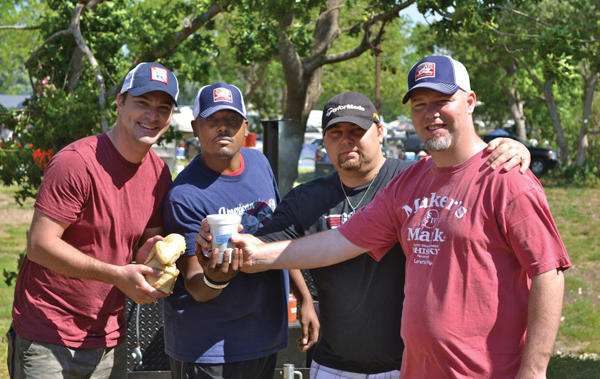 Oslynn Williams (second from left), a digital media professor and competitive barbecue chef, poses with his team, the Capps. Photo courtesy of Oslynn Williams.