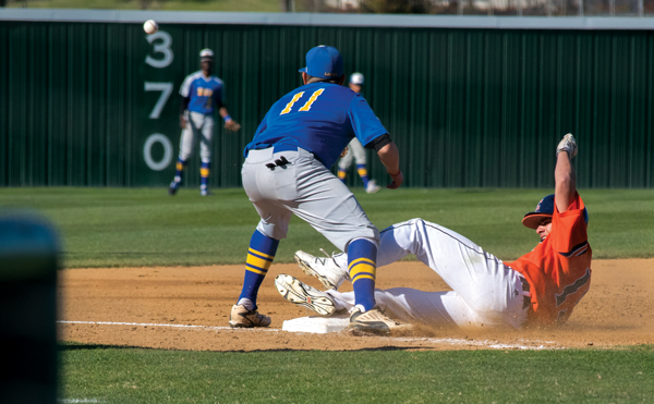 Gabe Guzman slides to the safety of third base as the Harvesters shut out the Mountain View Lions 11-0 on Feb. 24. Photo by Andrew Gonzales/The Et Cetera.