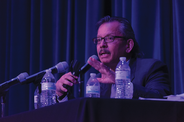 Host Victor Arriaga speaks at the March 20 immigration forum. Photo by Jesus Ayala/The Et Cetera
