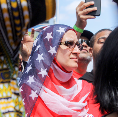 A protester dons an American flag hijab during the April 9 march. The event was a demonstration against President Donald Trumps recent immigration policy, which has conflicted with the views of advocates for undocumented immigrants and middle eastern refugees. Photo by Heidi McCaslin
