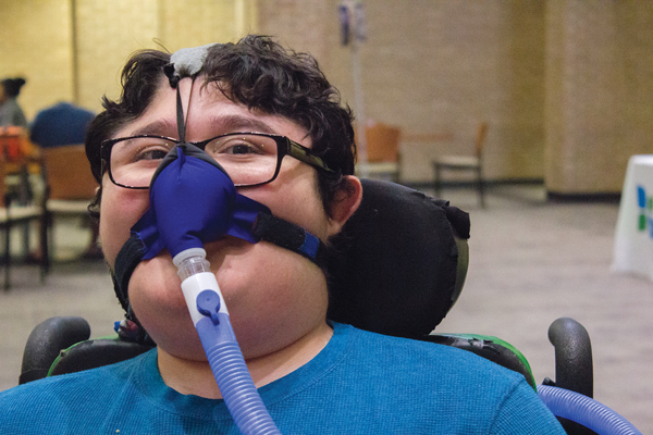 'I just want to survive': Student with muscular dystrophy fights through health issues, attends school