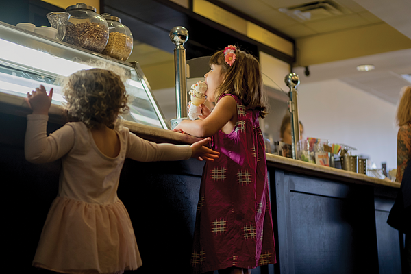 Children enjoy ice cream in the Hypnotic Emporium, owned by the founders of Hypnotic Donuts. Photo by Jesus Ayala/ The Et Cetera