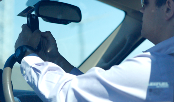 Texting while driving will be banned in Texas starting Sept. 1. (TNS)