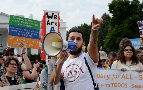 Protesters hold up signs during a rally supporting Deferred Action for Childhood Arrivals, or DACA, outside the White House on Tuesday, Sept. 5. Thousands are expected to gather for rallies on Tuesday, when President Donald Trump is slated to announce the program's future. Photo by Olivier Douliery/Abaca Press/TNS