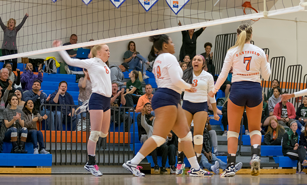 Eastfields volleyball team celebrates as they beat Cedar Valley in the conference semifinals. Photo by Jesus Ayala/The Et Cetera