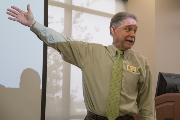 Mike Walker, interim vice president at Eastfield College, addresses student concerns over the colleges planned transition from 16 week courses to eight week courses Nov. 16. The transition has been met with mixed reaction from faculty and students alike. Photo by James Hartley/The Et Cetera