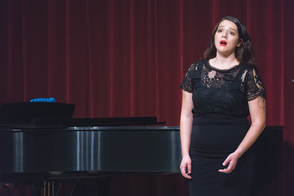 """Kincheloe performs solo piece, """"The Black Swan"""" by Gian Carlo Menotti from the play, """"The Medium"""", a dark, somber lullaby, at the Wednesday recital on November 1. Photo by Yesenia Alvarado/The Et Cetera"""