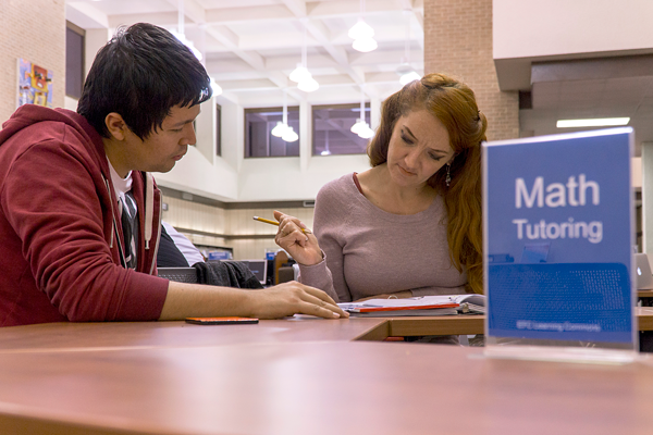 Melodie Stairs, Management major gets math tutoring help form computer science major, Luis Pulido, at the tutoring center in the library on Nov. 21, 2017. Photo by Yesenia Alvarado/The Et Cetera