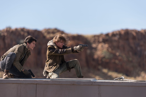 Thomas (left), played by Dylan OBrien and Newt (right), played by Thomas Brodie-Sangster, fend off a group of WCKD troops from atop a train car in The Death Cure. The film gives the Maze Runner series an intense, fitting finale. Photo courtesy of 20th Century Fox