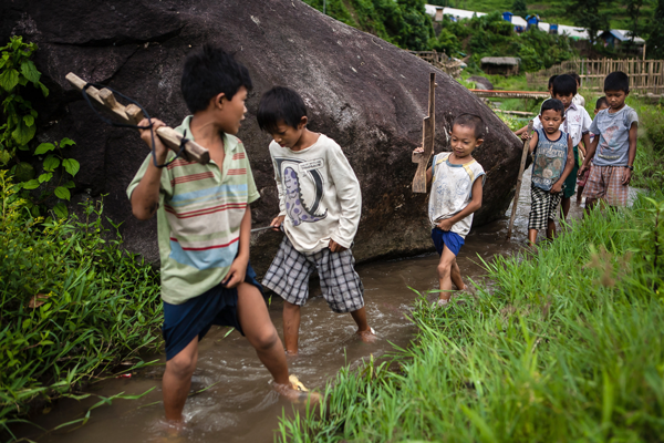 Young boys in Kachin state play war games while Morty Ortega covers the Kachin refugees' displacement. Courtesy of Morty Ortega