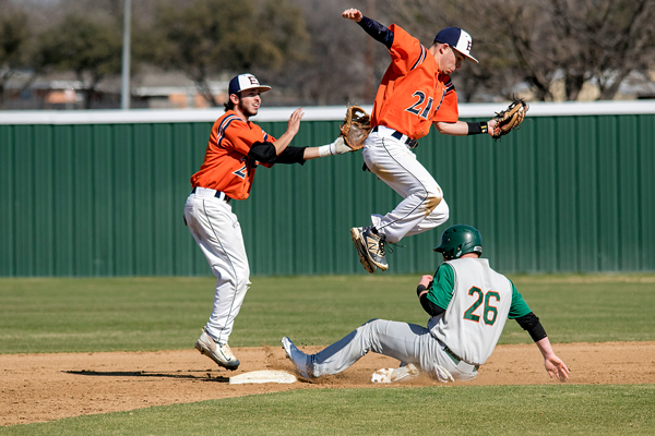 Eastfield's Jacob Perry (top right) catches the ball as UT Dallas' Peyton Becker (bottom right #26) attempts to slide to safety. The Harvesters won both double-header games 12-0 and 5-4 Jan. 29. Photo by Willie R. Cole/The Et Cetera
