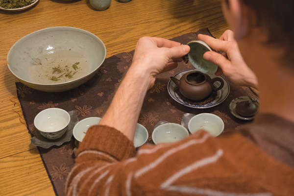 Jeff Cornelius serves tea with antique teaware and a technique called Gong Fu: the practice of making tea. Photo by Jesus Ayala/The Et Cetera