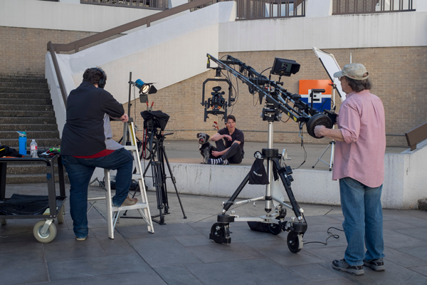 Nick Vera films a video on pet adoption with his dog, Stuff, in the designated free speech area in the lower courtyard. Photo by Jesus Ayala/The Et Cetera