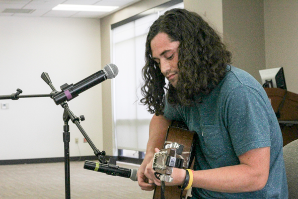 """Michael Posival, a member of Foundation 45 preformed eight original songs during the """"Unplugged: Breaking Stigma Through Music"""" event on March 29. Photo by Anthony Lazon/The Et Cetera"""