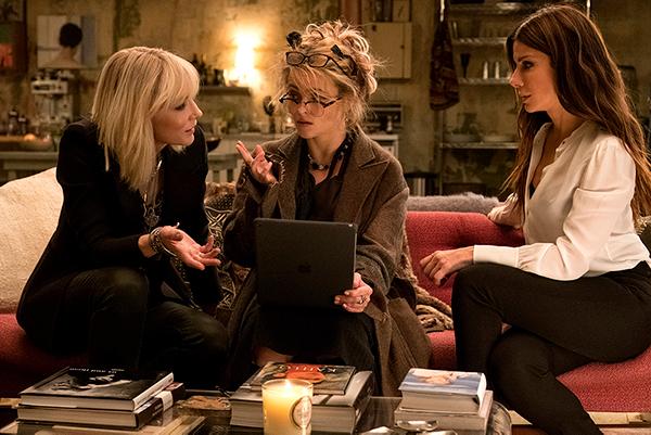 From left Cate Blanchett, Helena Bonham Carter and Sandra Bullock in a scene from