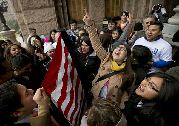 Maria Garcia leads chants at a protest march. Courtesy Maria Garcia