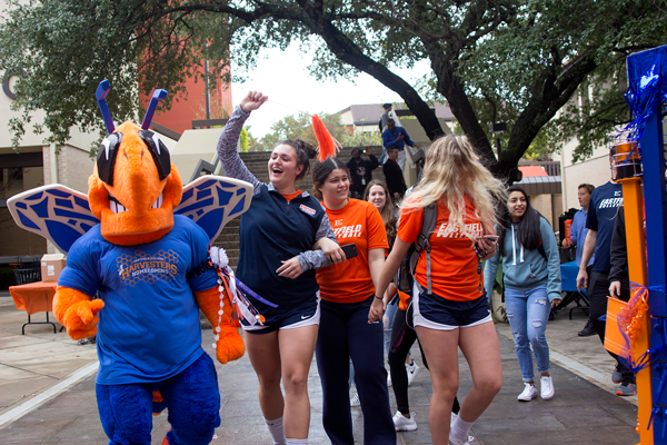Eastfields volleyball team members are celebrating with the mascot in the lower courtyard. Photo by Yesenia Alvarado/ The Et Cetera
