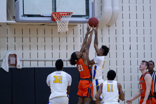 Guard Ta'Marcus Butler blocks a shot in the semifinals against the Mountain View Lions on Feb. 21. The Harvesters won 107-82. Photo by David Silva/The Et Cetera