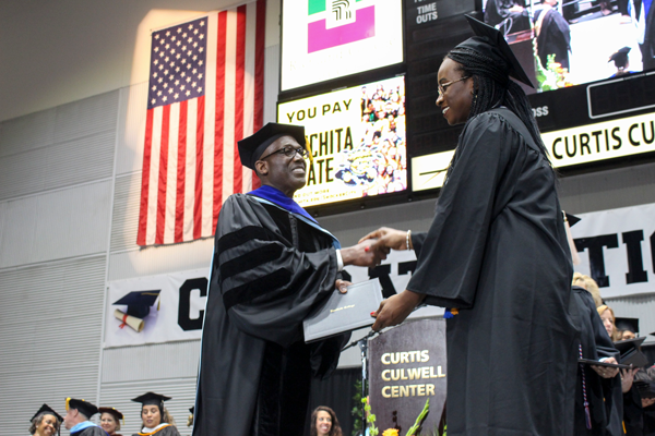 President Eddie Tealer shakes hands with a graduate at the 2019 graduation at the Curtis Culwell Center. Plans have been announced to hold in-person graduations for the class of 2021. Et Cetera File Photo