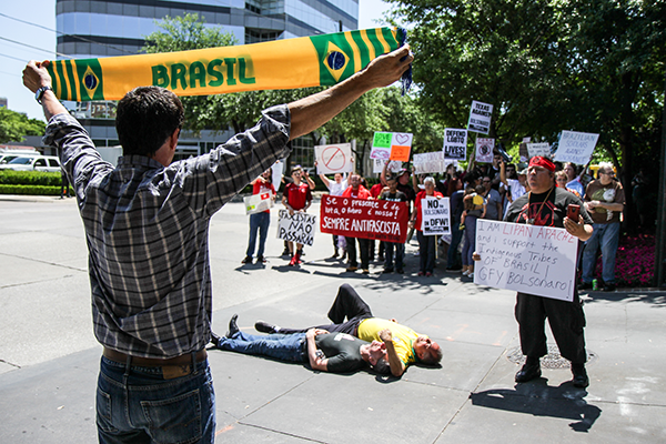 Leroy Pena of the Red Handed Warrior Society and former Eastfield College graduate confronts counter-protesters outside the Old Parkland building in Dallas on May 16. Protesters were vocal about President Bolsonaros stance on issues such as education, LGBTQ rights and environmental welfare. Photo by Anthony Lazon/The Et Cetera
