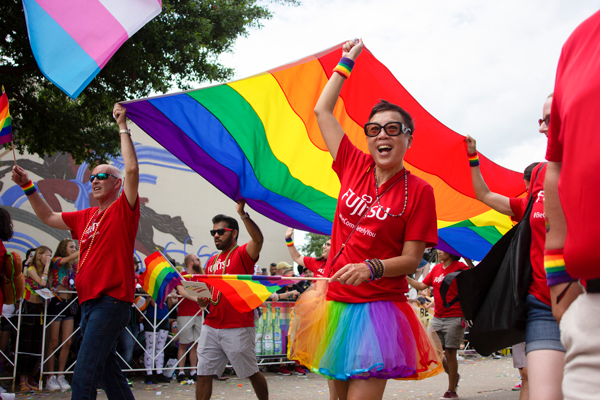 Members of the Japanese technology equipment company Fujitsu show their support of the LGBTQ community June 2. Photo by Yesenia Alvarado/The Et Cetera