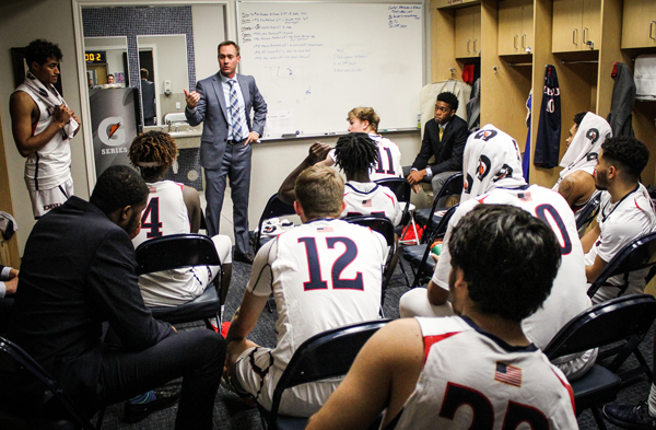 Beyond the playbook: Former Harvester point guard, distinguished alumnus teaches excellence on and off the court