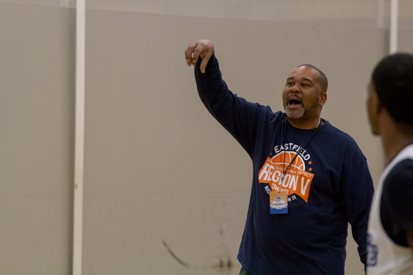 """Head coach Anthony Fletcher runs over drills with players at the practice gym in Rochester, Minnesota. He has been telling players to """"lock-in"""" all week. Photo by Skye Seipp/The Et Cetera"""