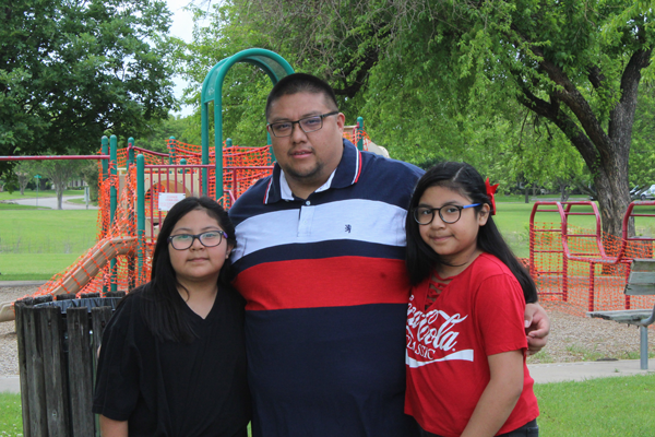 Family is essential: Single father, student, warehouse worker adjusts to new routines