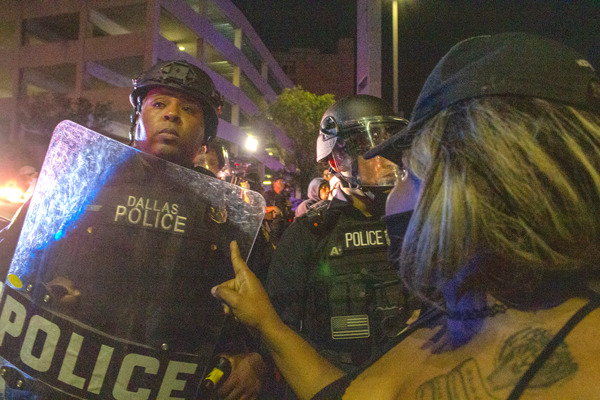 A woman points her finger and yells at police in riot gear on May 29. Photo by Skye Seipp/The Et Cetera