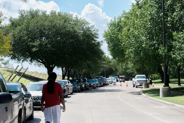 A line of people waits in their cars at the Mesquite Reception Center on Aug. 27 after evacuating areas that were going to be hit by Hurricane Laura. Photo by Chantilette Franklin/The Et Cetera