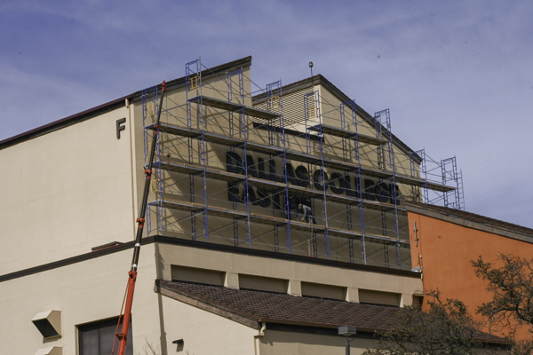 A worker puts up the sign that will replace the Eastfield College lettering on the F building on March 8. Photo by Chantilette Franklin/The Et Cetera