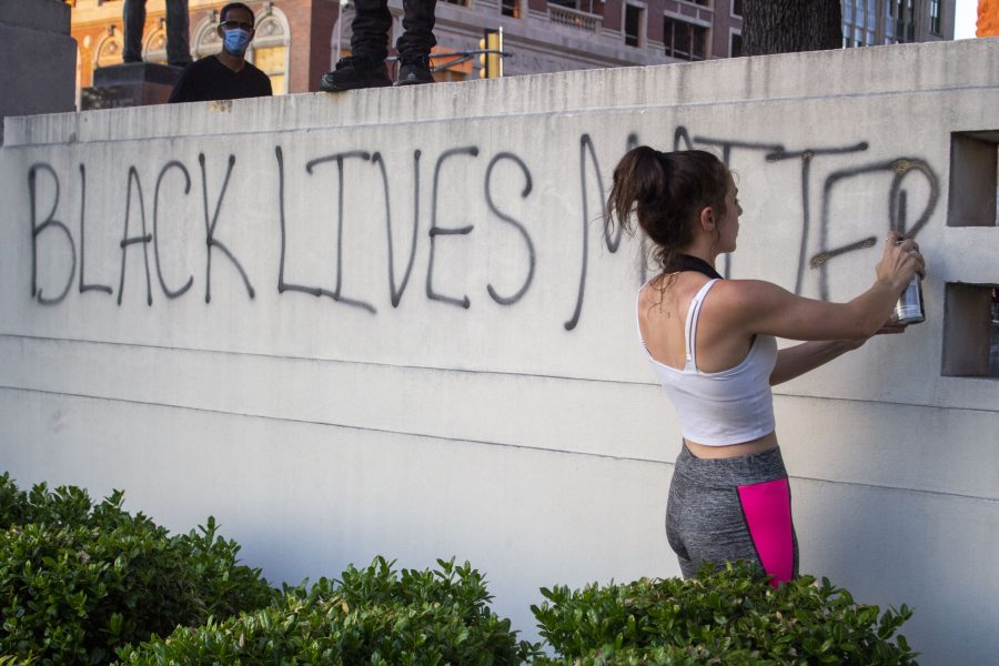 A+protester+following+George+Floyd%E2%80%99s+death+spray+paints+the+words+%E2%80%9CBlack+Lives+Matter%E2%80%9D+at+the+Dealey+Plaza+monument+in+Dallas+on+May+30%2C+2020.+Et+Cetera+File+Photos